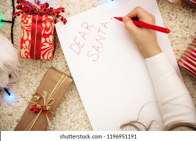 the girl lies and writes a letter to santa. Top view