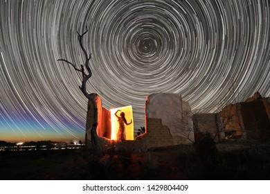 Girl Light Painted in the Desert Under the Night Sky