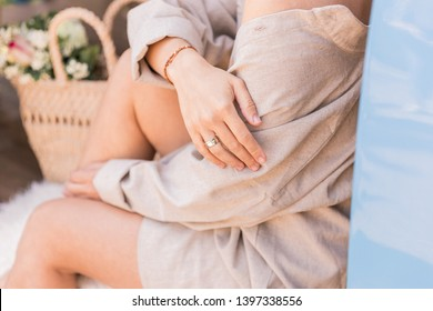 girl in a linen shirt with bare shoulder, stylish oversize shirt, beige natural shirt on girl