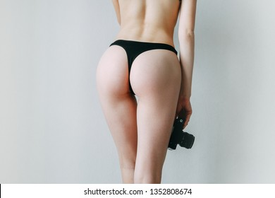 Girl in lingerie with a camera in her hands. Blogger on the cover of an advertising poster.