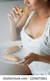 Girl in lingerie having Breakfast in the kitchen