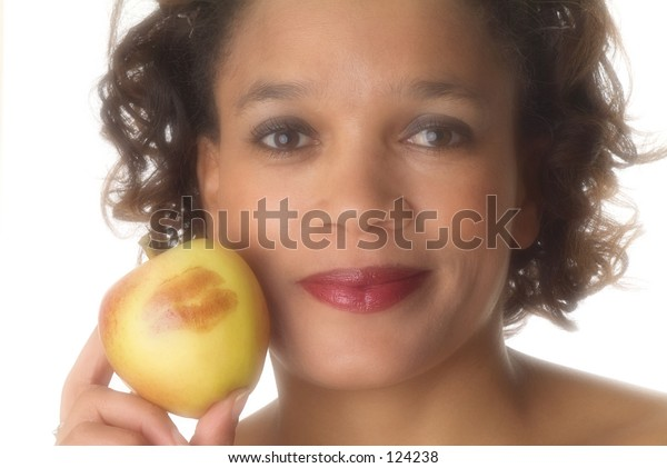 Girl with lipsticked apple