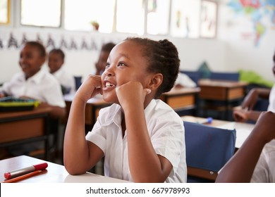 Girl listening during a lesson at an elementary school