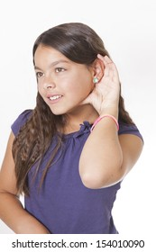girl listening with hand to ear isolated on a white background
