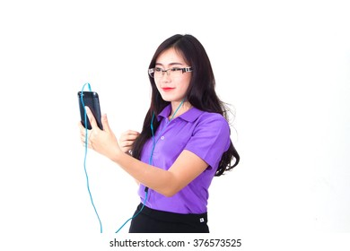 girl listening to the music with headphones on smart phone