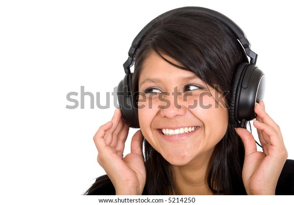 girl listening to music with headphones smiling over a white background
