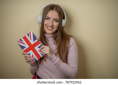 a girl listening to music, lessons english, news with the headphones