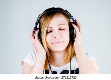 Girl listening to music on headphones.