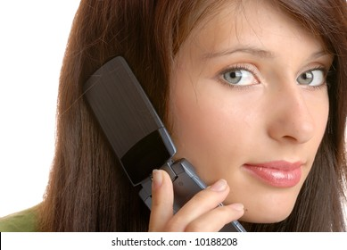A girl is listening to someone talking on a phone.