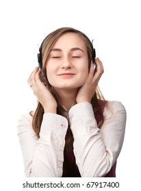 A girl listens to music with headphones isolated on white background