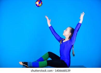 Girl little gymnast sports leotard. Physical education and gymnastics. Flexible healthy body. Practicing gymnastics hard before performance. Rhythmic gymnastics sport combines elements ballet dance.