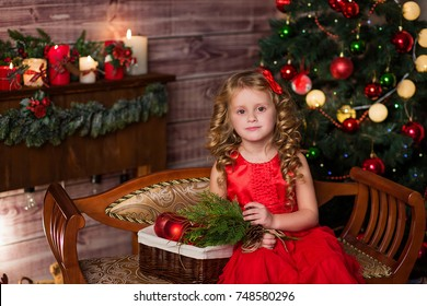 girl with long blond hair in the background of fireplace and Christmas tree