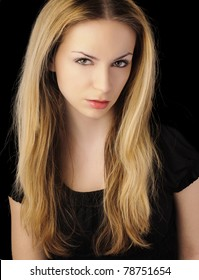 Girl with long blond hair, serious, mean expression