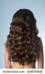 girl with long curly hair from behind