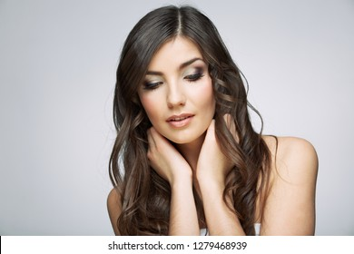Girl with long hair in beauty style. Female model studio isolated portrait.