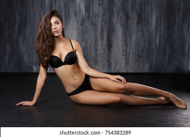girl with long hair in black swimsuit