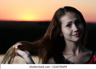 girl with long hair loose in nature