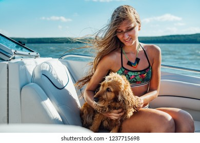 girl with long hair on the boat with a dog