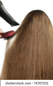 To the girl with long hair stack hairdress. The Rear view. It is isolated on a white background