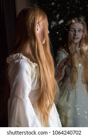 girl with long red hair looking into a alternate world in the mirror