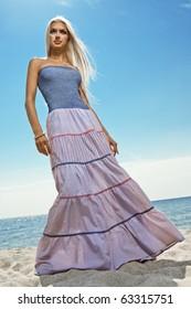 girl in long skirt on the seashore