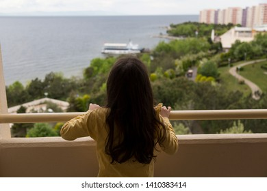 The girl look at the sea and holiday village or camp for tourism agent.