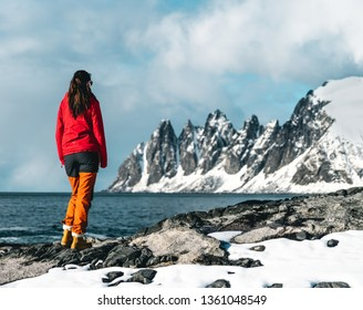 Girl, look at that mountain! Located on Senja Island, Norway.