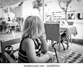 Girl looking away from camera at the resturant