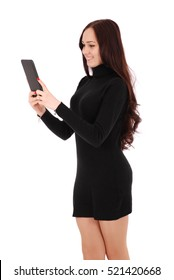 Girl looking at black tablet pc isolated on white