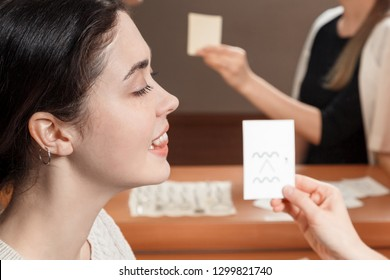 girl looking at the card says sounds.