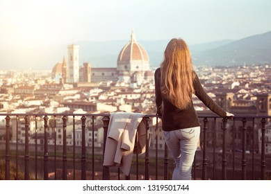 girl looking at the city of Florence from the viewpoint. Italy