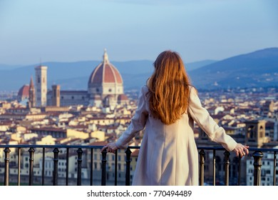 girl looking at the city of Florence from the viewpoint