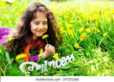 Girl looking at a dandelion and make a wish