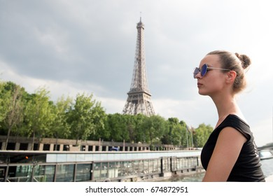 girl looking at eiffel tower in Paris, France. Black and white. Romantic travel concept