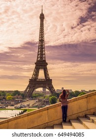 A girl is looking at Eiffel tower,Paris