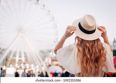 Girl is looking at the Ferris wheel. Ukraine, cotract area.