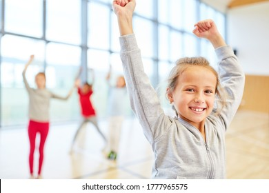 Girl is looking forward to physical education in the gymnasium of elementary school
