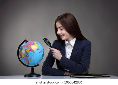 girl looking at globe.School.geography. study. education