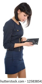 Girl looking into purse, shock on face, isolated over white.