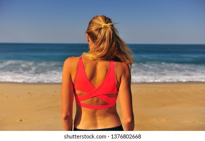 Girl looking at ocean on the clear sunny day