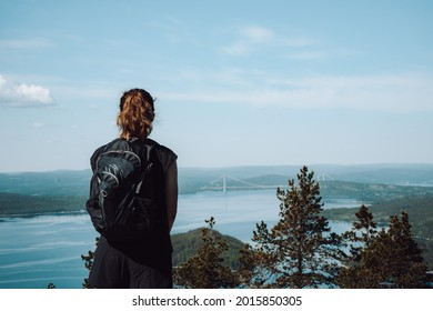 Girl looking out over the High Coast area, Sweden. Slightly toned down colors