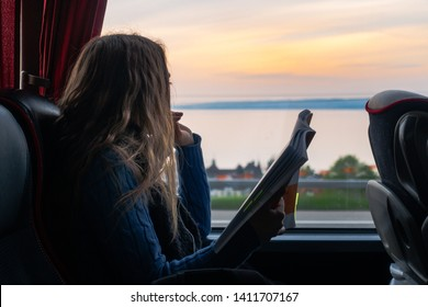 Girl Looking Out Window Reading Bus Sunset Landscape Peaceful Single