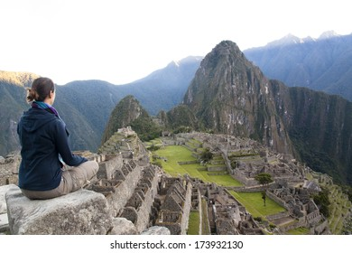 Girl looking over Machu Picchu, Peru