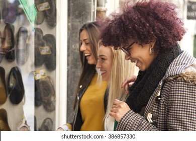 girl looking at shop window