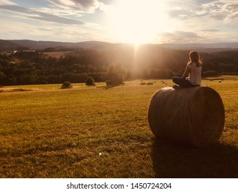 The Girl looking at sunset