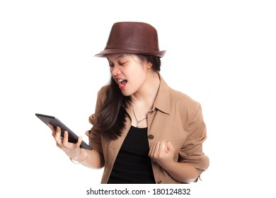Girl looking to tablet in her hand with surprise