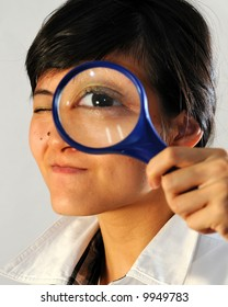 Girl looking through the magnifying glass
