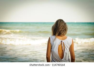 Girl looking through the sea