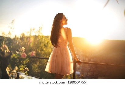 Girl looking the view from a balcony