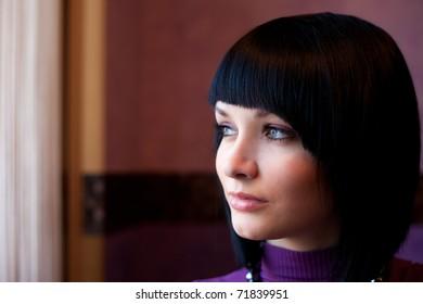girl looking in window face portrait